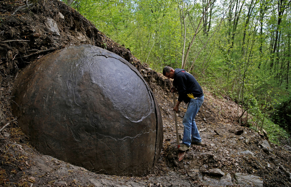 Suad Keserovic Cleans A Stone Ball In Podubravlje Village Near Zavidovici